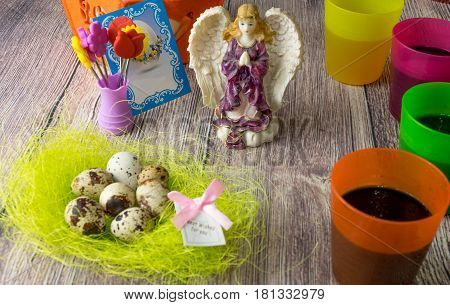 colored Easter egg decorated on the table in the holiday of light Christ is Risen in different colors with Angel