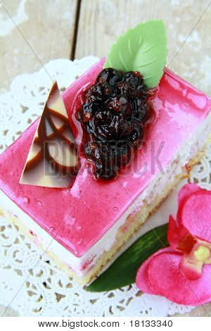A piece of cake with black currant
