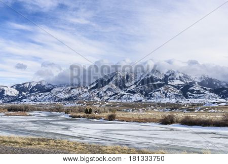 Yellowstone River in Wyoming in Winter with Snow Covered Mountains