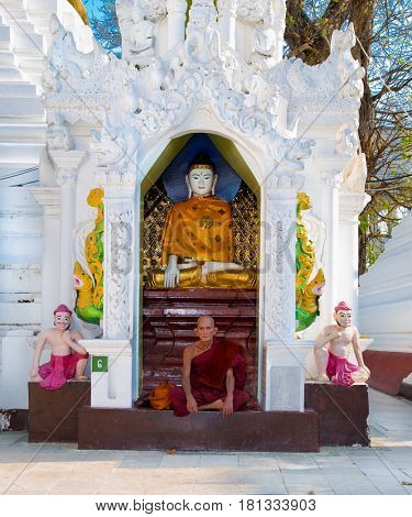 YANGON, MYANMAR-MARCH 2, 2017: Ascetic Buddhist monk meditating at Shwedagon Paya pagoda on March 2, 2017 in Yangon. Myanmar. (Burama)