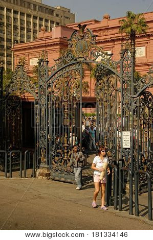 Cairo, Egypt - November 11, 2006: The Egyptian Museum in Cairo, one of the most famous museums of the world. Female tourist exit from museum gate