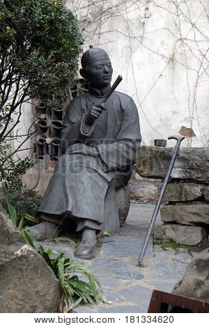 XITANG - FEBRUARY 20: Statue in Xitang Ming and Qing Dynasty Residence Wood Carving Exhibition Hall, Xitang town in Zhejiang Province, China, February 20, 2016.