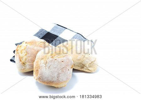 Mini Crusty Hamburger Bread Isolated In White Background With A Checked Blue Kitchen Towel