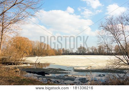 Early spring, melting snow and ice, the forest lake is freed of ice 3