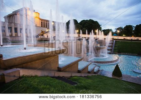 Fountains in Paris at the Trocadero square near the Palace of Chaillot. Travel through Europe. Attractions in France. Grey Sky