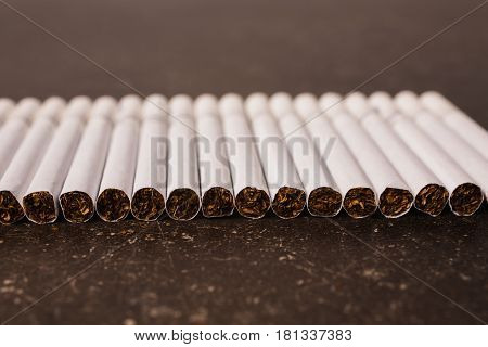 Cigarettes on a dark marble background. Bad habit. Health care. Cancer concept. Bad habits of cancer