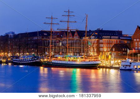 A view of the Schliachte embankment and St. Martin's church in the night illumination. Bremen. Germany.