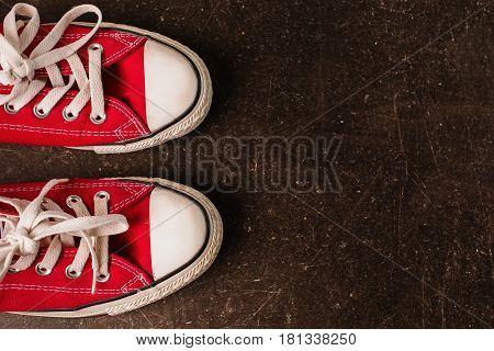Sport shoes. Red sneakers on a dark marble background. Footwear for outdoor activities. Footwear for sport. Sneakers for sport