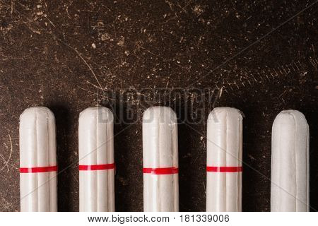Hygiene concept. Female white tampons on a dark marble background. Hygiene. To observe hygiene