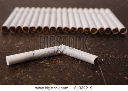 Cigarettes on a dark marble background. Bad habit. Care for health. Leave off smoking Cigarettes concept