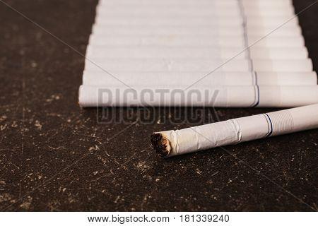 Cigarettes on a dark marble background. Bad habit. Health care. Cigarettes concept