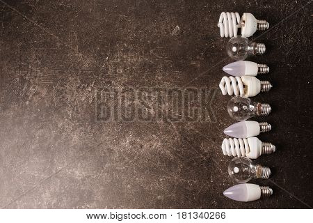 LED bulb incandescent light lamp fluorescent lamp on a dark marble background. To save energy. Eco concept with light lamp. Save light and energy