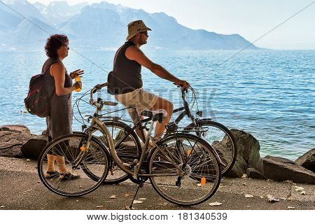 Man Riding Bicycle At Embankment Of Geneva Lake In Montreux