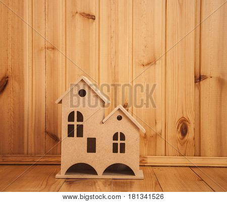 small house on a wood background