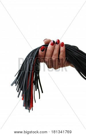 Isolated tails of a leather red-black lash in a female hand on a white background poster