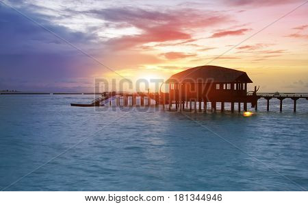 houses over the transparent quiet sea water on a sunset