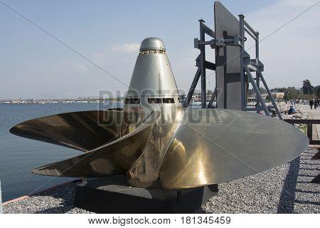 It's a war ship a propeller. Piece of sunken ship