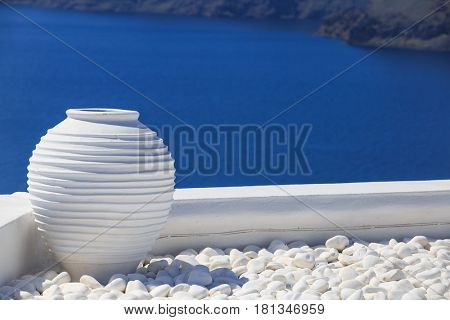 Ceramic pottery on the roof with volcano of Santorini on the background
