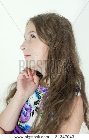 Cute teen girl thinking portrait on white background