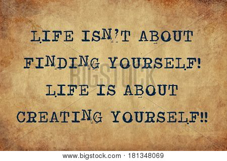 Inspiring motivation quote of life isn't about finding yourself life is about creating yourself with typewriter text. Distressed Old Paper with Typing image.