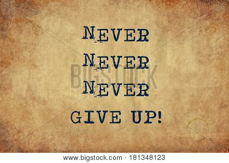 Inspiring motivation quote of never never never give up with typewriter text. Distressed Old Paper with Typing image.