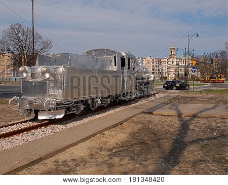 Locomotive and church. Lodz, Poland - March 31, 2017 Decorated historic locomotive and church of Alexander Newski in the center of Lodz.
