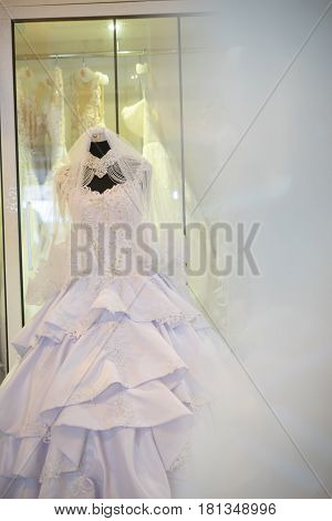 white wedding dress gown on mannequin in bridal gown. Bride's morning wedding preparation concept
