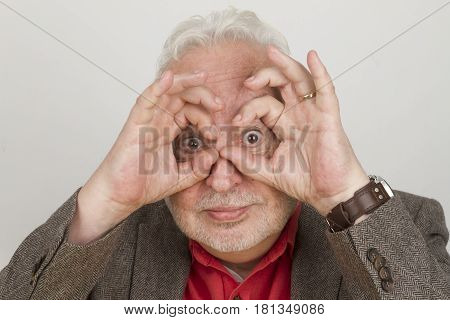 Eldery person focusing on the future - on bright background
