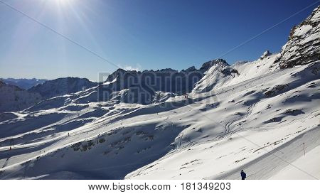 The highest point of Germany oversees many peaks of the Alps on both German and Austrian sides.