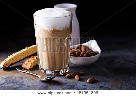 Coffee latte with almond milk and biscotti