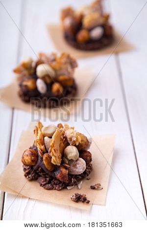 Raw oatmeal granola and nuts mix healty cookies snack with cocoa banana cream