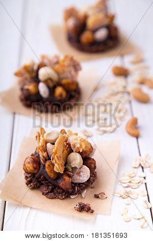 Raw wheat granola and nuts mix healty snacks with cocoa banana cream
