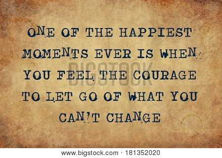 Inspiring motivation quote of one of the happiest moments ever is when you feel the courage to let go of what you can't change with typewriter text. Distressed Old Paper with Typing image.