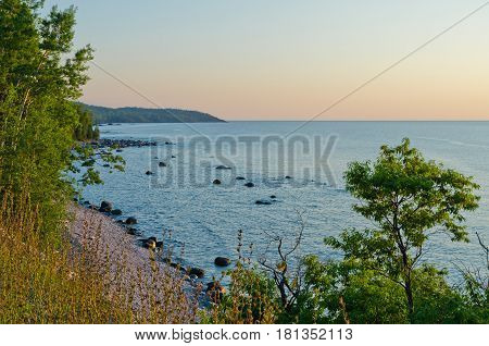 Rocky shore of Superior Lake at sunset