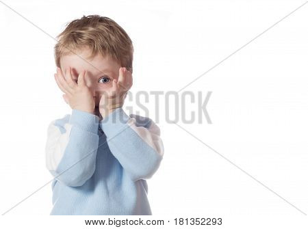 The little boy is watching. The child was frightened. Boy is isolated on a white background.