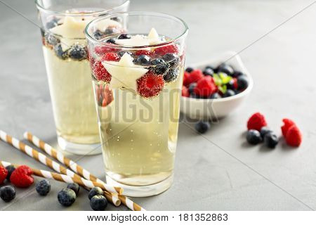 Red, blue and white sangria with sparkling wine