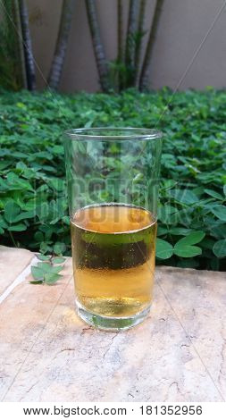 A half full glass cup with beer
