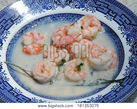 Cooked shrimps with coconut sauce on a plate