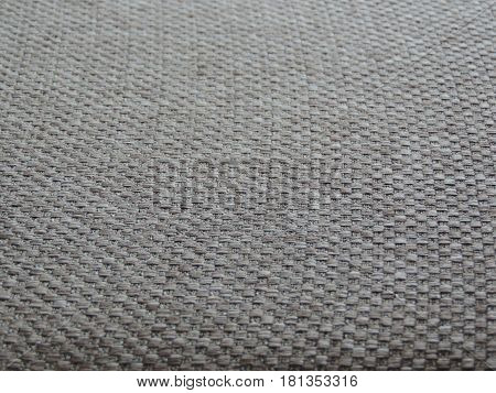 Background of a gray fabric with relief
