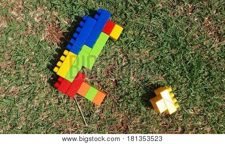 The plastic colorful toys on the grass