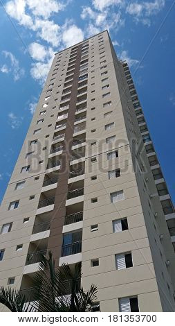 The facade of a tall residential building