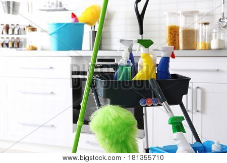 Janitor cart with cleaning equipment in kitchen