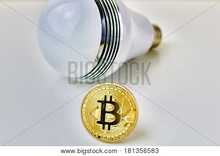 Physical bitcoin gold coin and big bulb