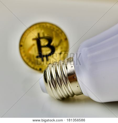 Bitcoin cryptocurrency gold coin and white big bulb
