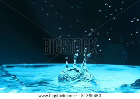 Water Splash background / Water is a transparent and nearly colorless chemical substance that is the main constituent of Earth's streams, lakes, and oceans, and the fluids of most living