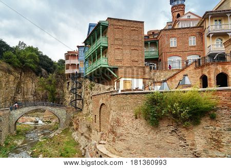 River With Bridge And Houses In Abanotubani District In The Old Town Of Tbilisi. Georgia