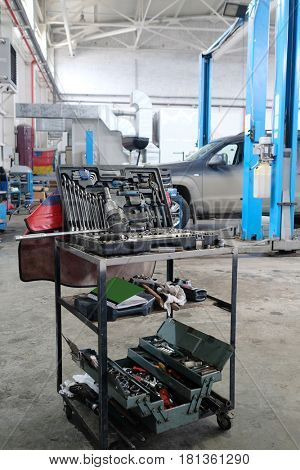 Stupino, Moscow region, Russia - April, 4, 2017: Interior of a car repair station in Stupino, Russia. There is a tool's trolley on the frontground