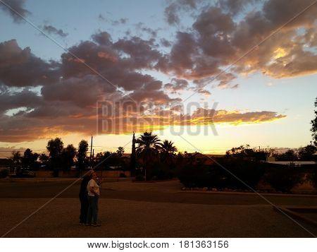 Older adults couple watching the sunset. Tucson, AZ, circa January of 2017