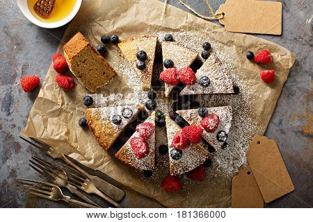 Gluten free cake with almond and brown rice flour served with fresh fruit overhead shot