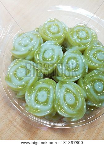 Thai dessert, rose shaped sweet layer cake, in plastic package.